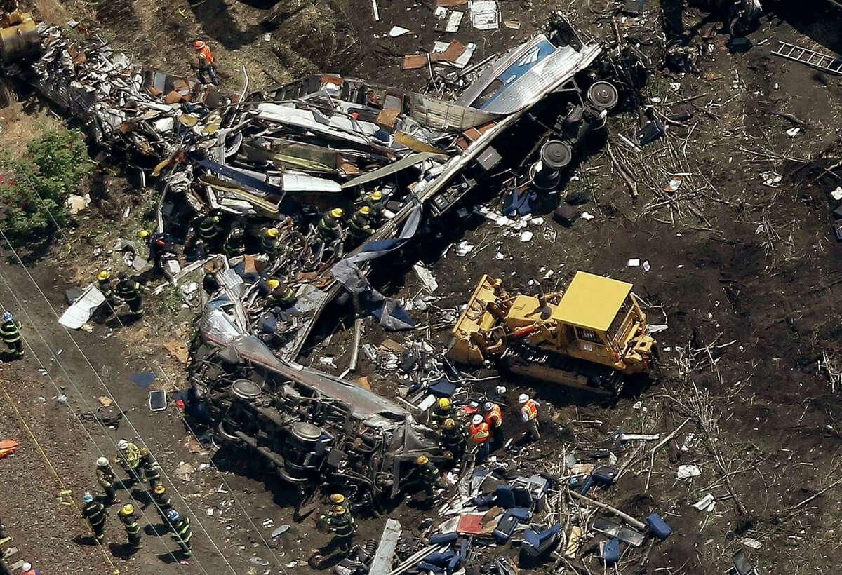PHILADELPHIA, PA - MAY 13: Investigators and first responders work near the wreckage of an Amtrak passenger train carrying more than 200 passengers from Washington, DC to New York that derailed late last night May 13, 2015 in north Philadelphia, Pennsylvania. At least five people were killed and more than 50 others were injured in the crash. (Photo by Win McNamee/Getty Images) ORG XMIT: 554054473
