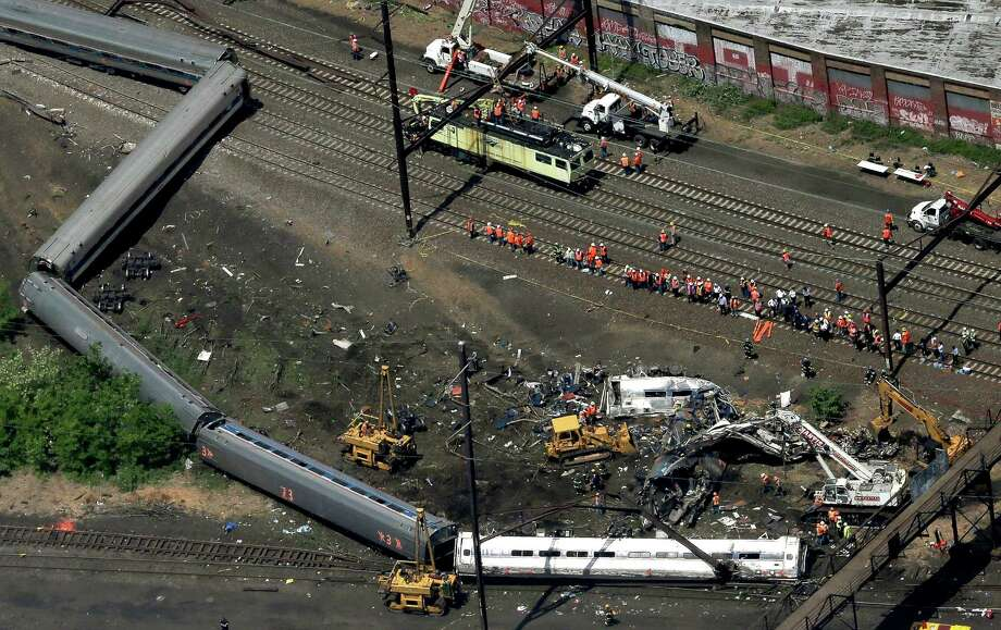 PHILADELPHIA, PA - MAY 13:  Investigators and first responders work near the wreckage of an Amtrak passenger train carrying more than 200 passengers from Washington, DC to New York that derailed late last night May 13, 2015 in north Philadelphia, Pennsylvania. At least five people were killed and more than 50 others were injured in the crash.  (Photo by Win McNamee/Getty Images) ORG XMIT: 554054473 Photo: Win McNamee / 2015 Getty Images