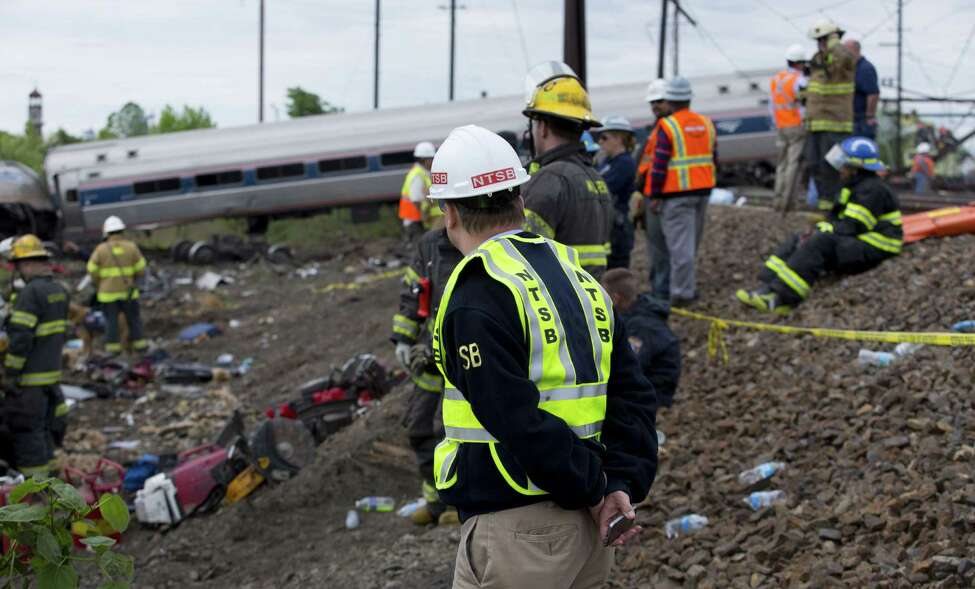 PHILADELPHIA, PA - MAY 13: In this handout image supplied by NTSB, NTSB member Robert Sumwalt works on the scene of the Amtrak Train #188 derailment on May 13, 2015 in Philadelphia, Pennsylvania. Service has been interrupted after Amtrak train derailed in Philadelphia last night, killing at least seven people and injured more than 200. (Photo by NTSBgov via Getty Images) ORG XMIT: 554054473