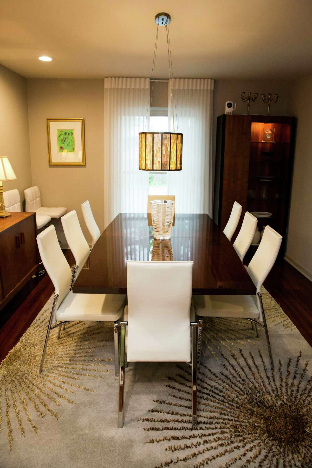 White leather-and-chrome dining chairs set off the sleek black table in the dining room of Gerry Garcia and Jack Elsbree.