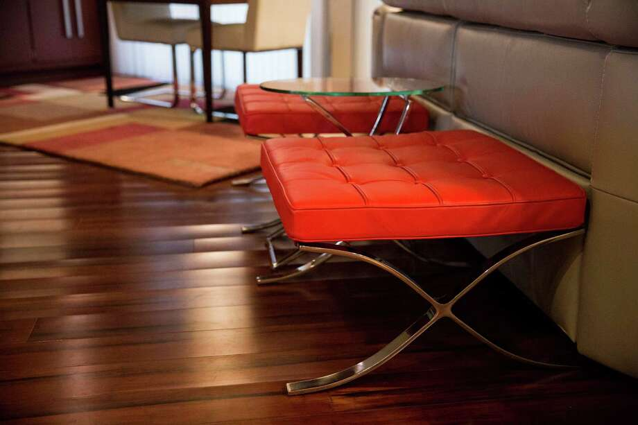 Red ottomans at the home of Gerry Garcia and Jack Elsbree. Photo: Carolyn Van Houten /San Antonio Express-News / 2015 San Antonio Express-News
