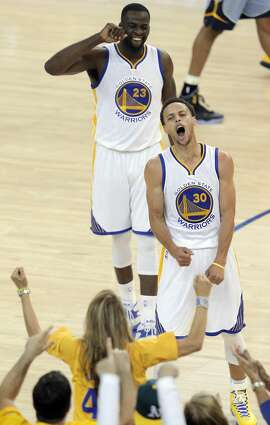 Stephen Curry (30) reacts after hitting a three-pointer to tie the game In the first half. The Golden State Warriors played the Memphis Grizzlies in Game 5 of the Western Conference Semifinals at Oracle Arena in Oakland, Calif., on Wednesday, May 13, 2015.