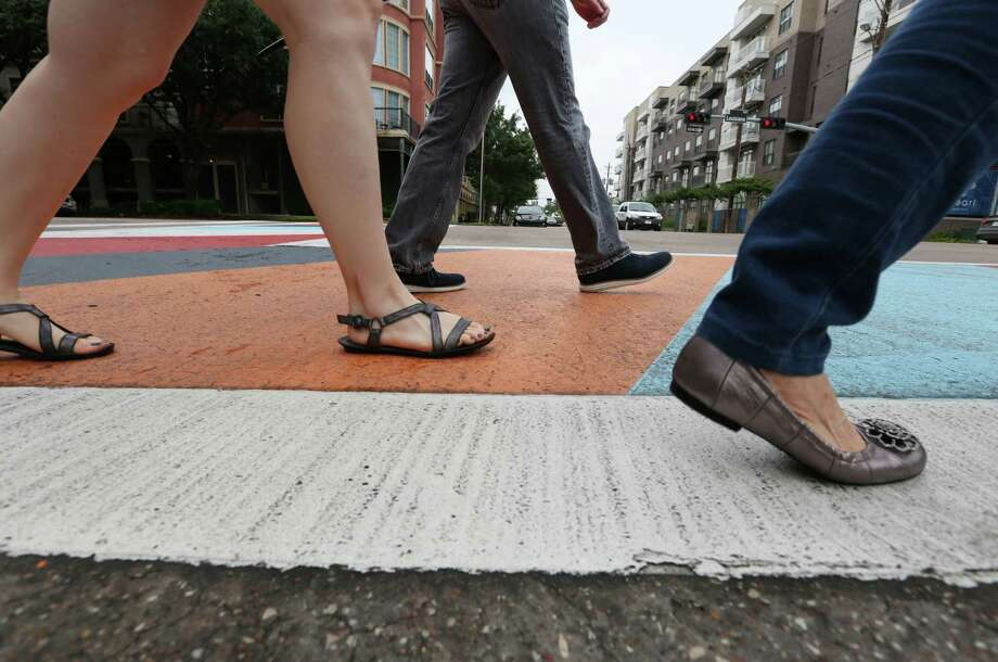 Pedestrians cross at a colorful crosswalk at the intersection of Elgin and Louisiana on May 12, 2015. Photo: Jon Shapley, Houston Chronicle / © 2015 Houston Chronicle