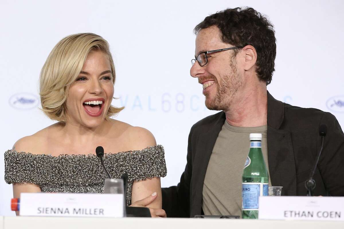 Actress Sienna Miller, left, laughs as she sits alongside jury president Ethan Coen during a press conference for the jury at the 68th international film festival, Cannes, southern France, Wednesday, May 13, 2015.