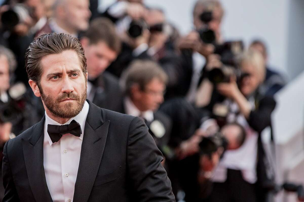 Jake Gyllenhaal arrives for the opening ceremony and the screening of the film La Tete en Haut (Standing Tall) at the 68th international film festival, Cannes, southern France, Wednesday, May 13, 2015.