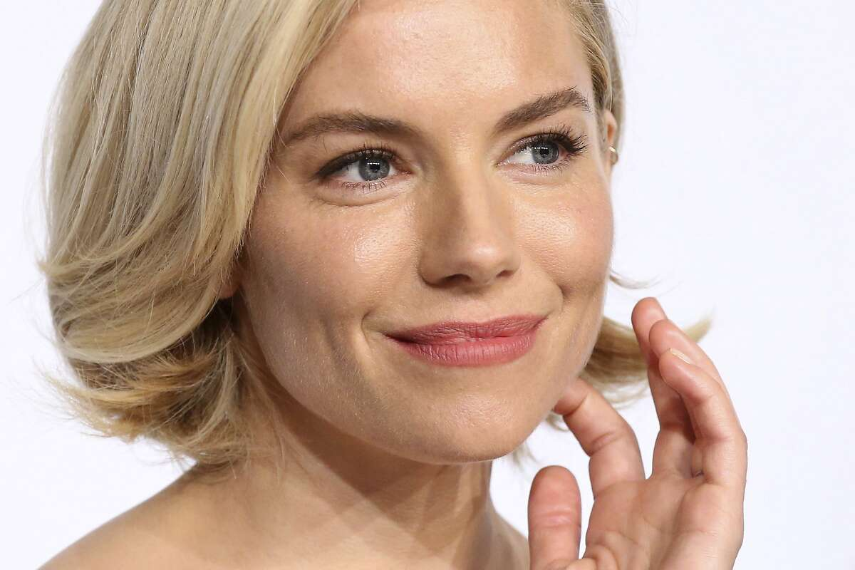 Actress Sienna Miller attends a press conference for the jury at the 68th international film festival, Cannes, southern France, Wednesday, May 13, 2015.