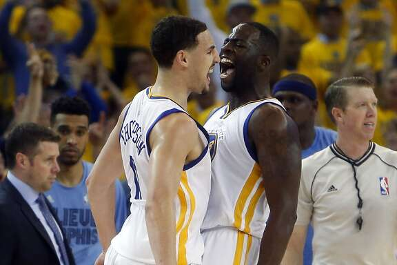 Golden State Warriors' Klay Thompson and Draymond Green celebrate Thompson's 3-pointer and a foul in 4th quarter of 98-78 win over Memphis Grizzlies during Game 5 of NBA Playoffs' Western Conference Semifinals at Oracle Arena in Oakland, Calif., on Wednesday, May 13, 2015.