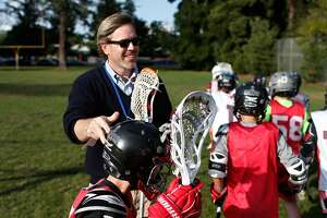 Bradford Stroh, CEO of Bills.com and coach of his son's lacrosse team, leads practice on Wednesday, May 13, 2015 in Redwood City, Calif.
