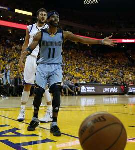 Memphis Grizzlies' Mike Conley debates an official's call as Golden State Warriors' Andrew Bogut looks on during Warriors' 98-78 win in Game 5 of NBA Playoffs' Western Conference Semifinals at Oracle Arena in Oakland, Calif., on Wednesday, May 13, 2015.