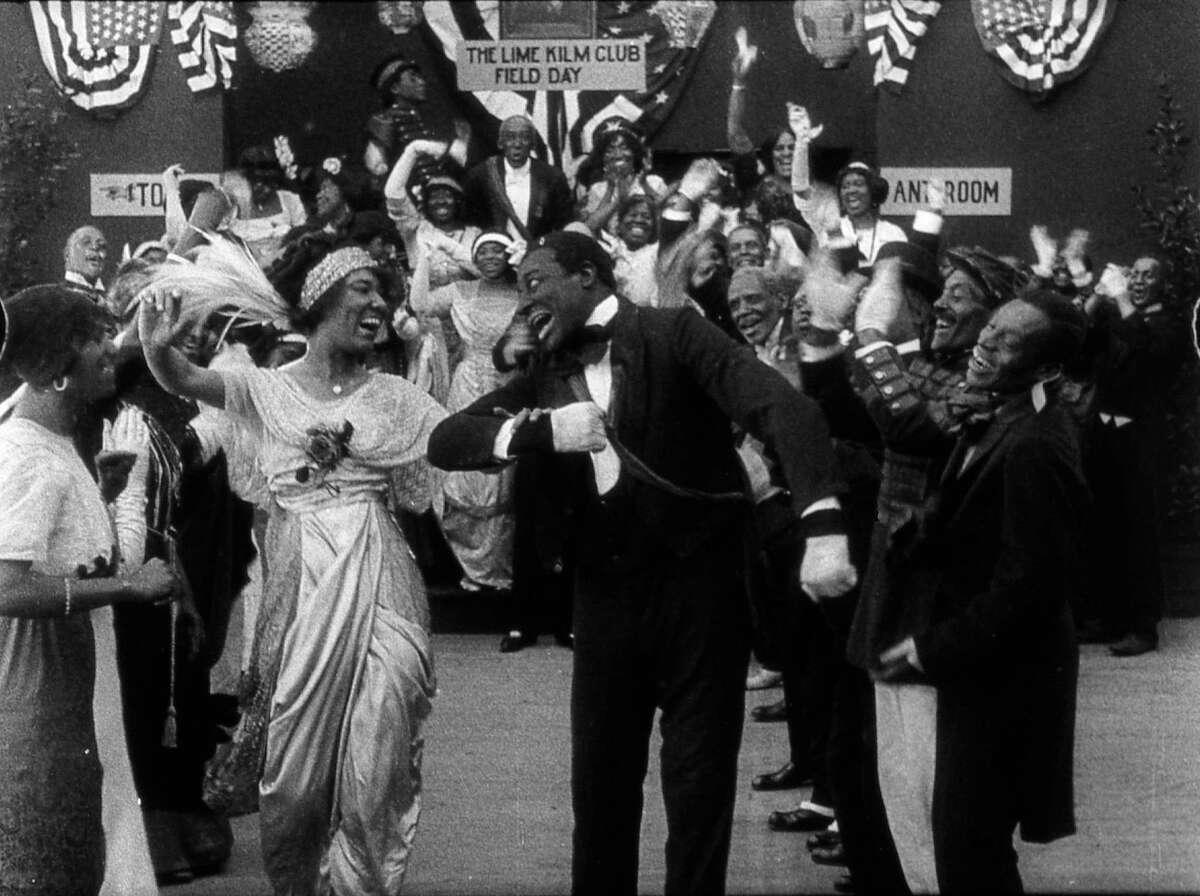 "Odessa Warren Grey and Bert Williams in ""Lime Kiln Field Day,"" a 1913 silent film."