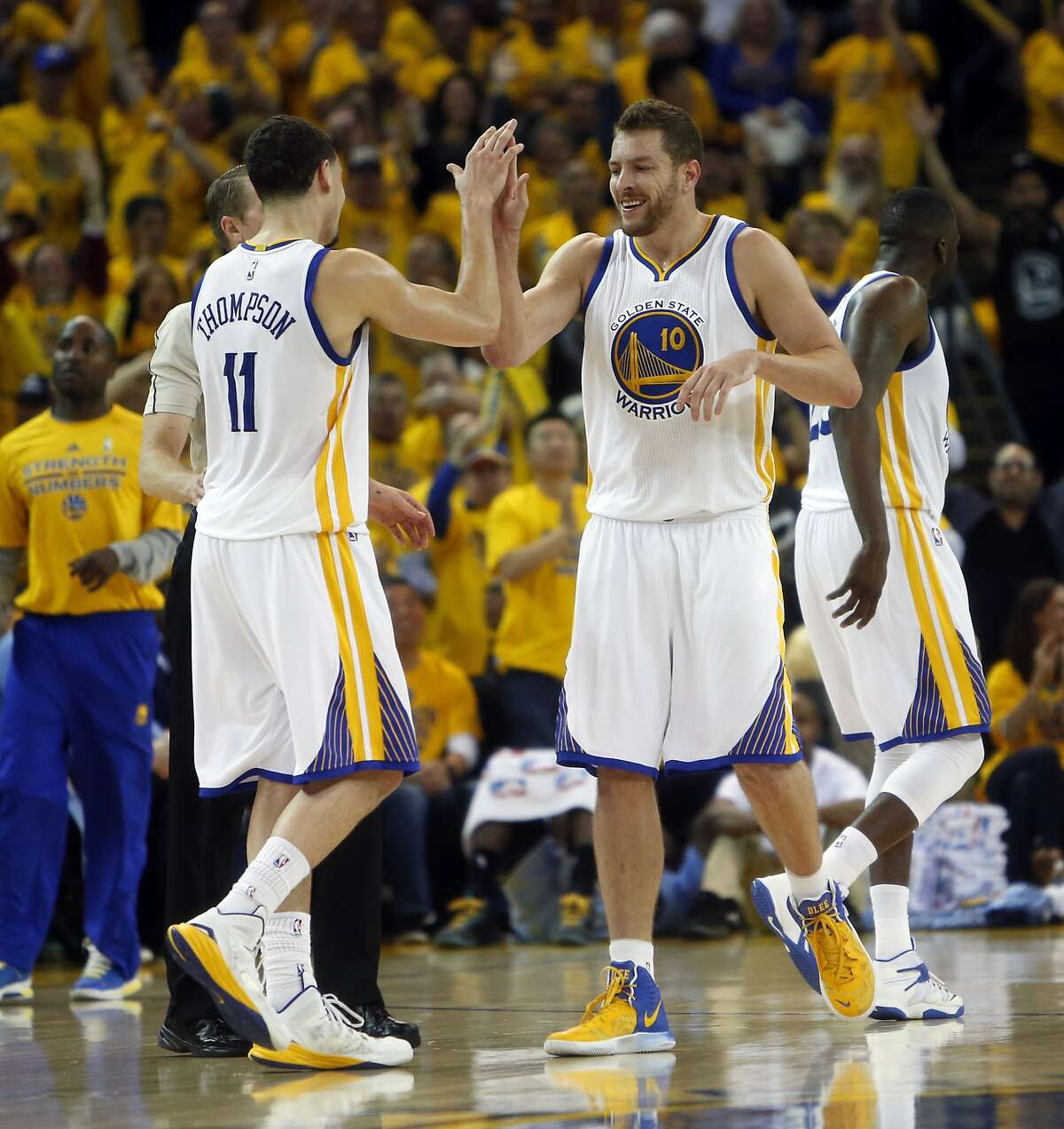 Golden State Warriors' David Lee and Klay Thompson celebrate in 4th quarter during 98-78 win over Memphis Grizzlies during Game 5 of NBA Playoffs' Western Conference Semifinals at Oracle Arena in Oakland, Calif., on Wednesday, May 13, 2015.