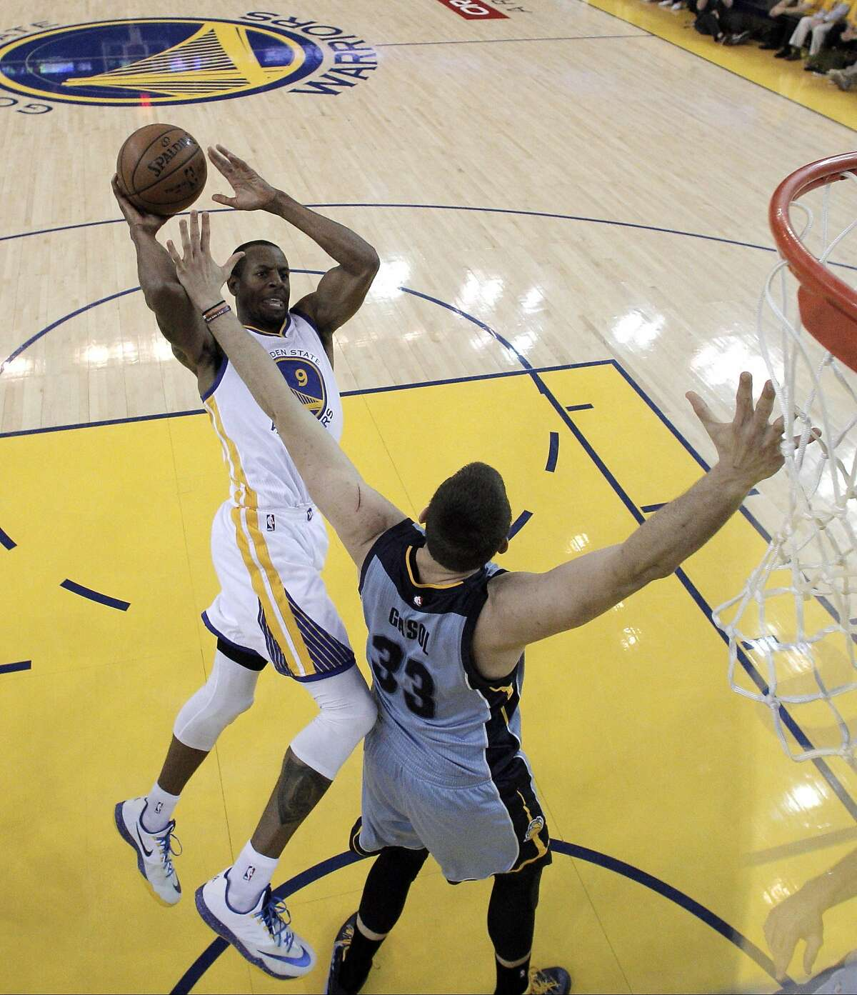 Andrew Iguodala (9) puts in a shot over Marc Gasol (33)) In the first half. The Golden State Warriors played the Memphis Grizzlies in Game 5 of the Western Conference Semifinals at Oracle Arena in Oakland, Calif., on Wednesday, May 13, 2015. The Warriors defeated the Grizzlies 98-78.