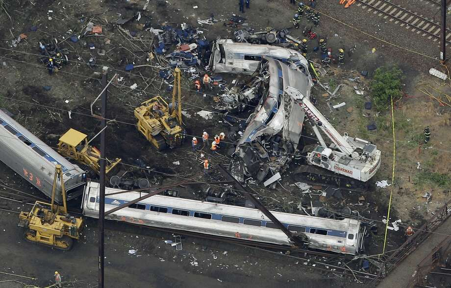 In this aerial photo, emergency personnel work at the scene of a deadly train wreck, Wednesday, May 13, 2015, in Philadelphia. Federal investigators arrived Wednesday to determine why an Amtrak train jumped the tracks in a wreck that killed at least six people, and injured dozens. Photo: Patrick Semansky, Associated Press