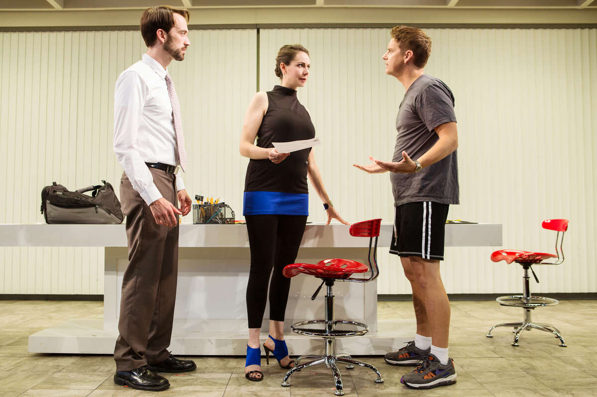 Joe (Kyle Cameron, left) and his assistant Kelly (Liz Sklar) receive directives from their boss Dennis (Patrick Russell) fro a new TV project in