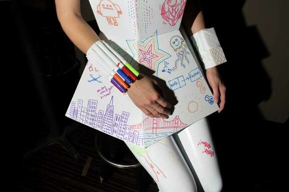 Anna Sergeeva wears a Natalie Walsh whiteboard dress at Silicon Valley Fashion Week?, an event that features tech wearables at The Chapel in San Francisco, Calif. on Wednesday, May 13, 2015.