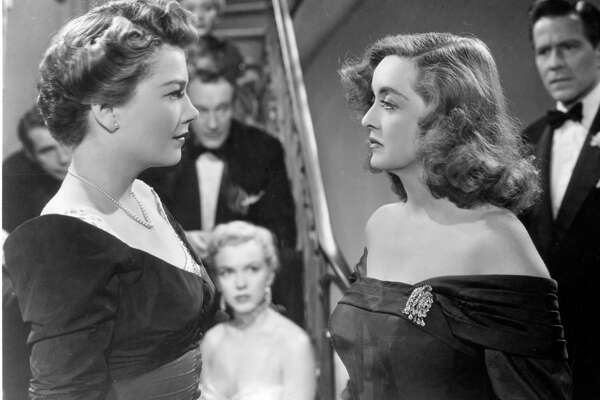"Anne Baxter, left, and Bette Davis in the 1950 film, ""All About Eve,"" depicted the artistic elite in mid-century New York."