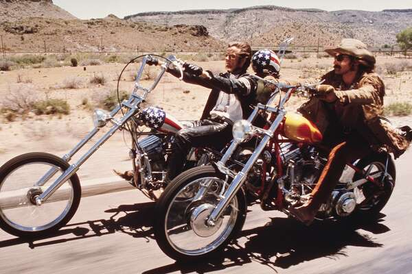 """American actors Dennis Hopper and Peter Fonda ride through the Desert on motorcycles in a scene from the film 'Easy Rider,"""" not a great film by any stretch, but a cultural marker."""
