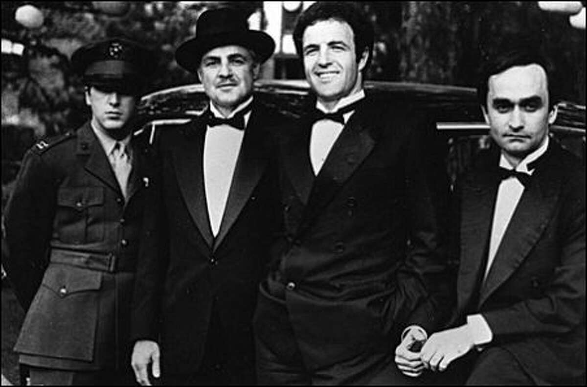 James Caan as Sonny Corleone , Marlon Brando as Vito Corleone and John Cazale as Fredo Corleone in