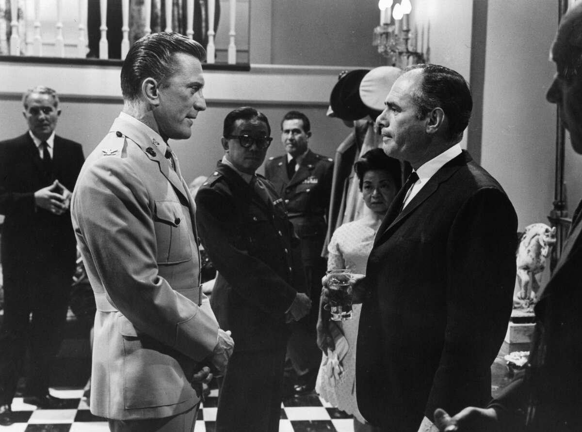 Kirk Douglas in a military uniform speaking with an unknown actor in a scene from the film 'Seven Days In May', 1963, about the threat of a right-wing coup.