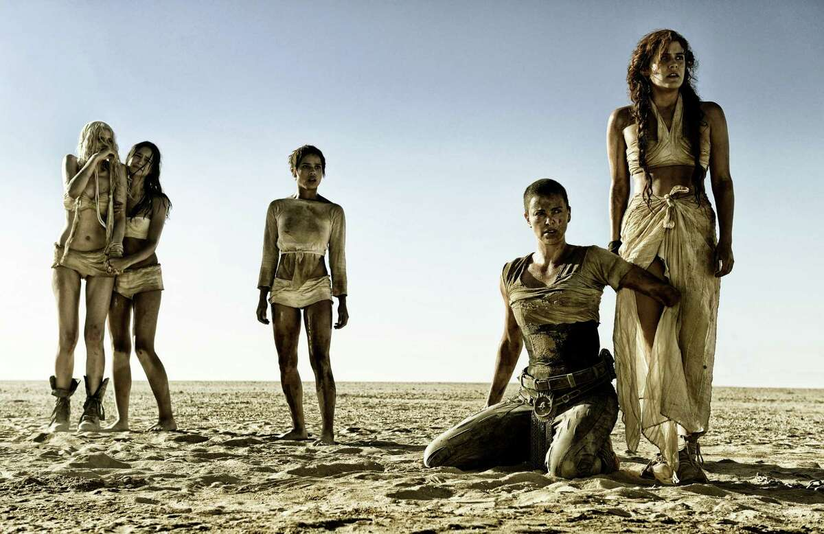 """This photo provided by Warner Bros. Pictures shows, from left, Abbey Lee as The Dag, Courtney Eaton as Cheedo the Fragile, Zoe Kravitz as Toast the Knowing, Charlize Theron as Imperator Furiosa and Riley Keough as Capable, in Warner Bros. Pictures?' and Village Roadshow Pictures?' action adventure film, ?""""Mad Max:Fury Road,"""" a Warner Bros. Pictures release. (Jasin Boland/Warner Bros. Pictures via AP)"""