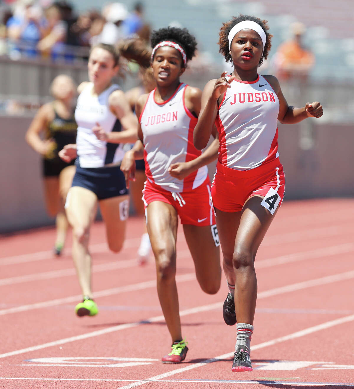 Judson's Darionne Gibson (right) beats teammate Zantori Dickerson to the finish line of the Class 6A 400-meter dash during the Region IV-5A and Region IV-6A track and field meet at Alamo Stadium on May 2, 2015. Gibson won the event with a time of 55.50 seconds. Dickerson finished second with 55.98 seconds.