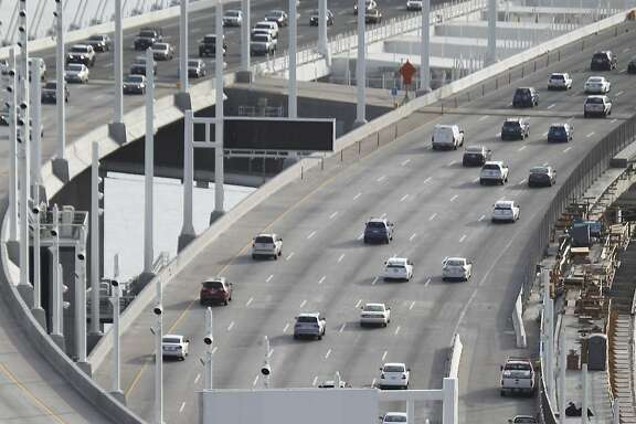 An AC Transit bus crosses the Bay Bridge towards San Francisco, Calif. on Thursday, May 14, 2015. Transit planners are exploring the possibility of converting one of the eastbound lanes on the Bay Bridge into a single transit-only lane for westbound buses during the morning commute. The idea is that buses would bypass congested rush hour traffic.