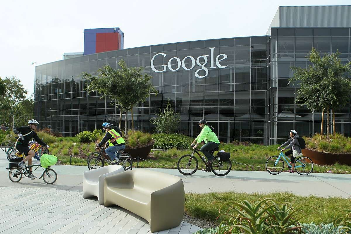 Cyclists make their way around the Googleplex during Bike to Work Day, Thursday, May 14, 2015, in Mountain View, Calif. The company provided fueling stations, sports massages, a DJ and breakfast to get employees pumped up for biking. Google estimates more than 2,200 employees biked to work today.