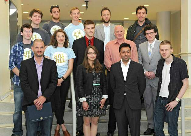 """Winners including Food Pantry, Electorate, Snapmap, Project Hunt, Ant Hill and Eveny pose for a photo after AT&T announced the winners of its $18,000 """"app challenge"""" for local developers at the University at Albany on Thursday, May 14, 2015 in Albany, N.Y. (Lori Van Buren / Times Union) Photo: Lori Van Buren / 10031848A"""