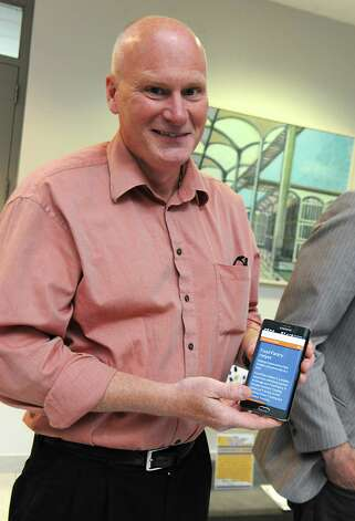 """Russell Kirkwood of Stillwater received the grand prize of $10,000 for his app Food Pantry Helper as AT&T announces winners of its $18,000 """"app challenge"""" for local developers at the University at Albany on Thursday, May 14, 2015 in Albany, N.Y. (Lori Van Buren / Times Union) Photo: Lori Van Buren / 10031848A"""