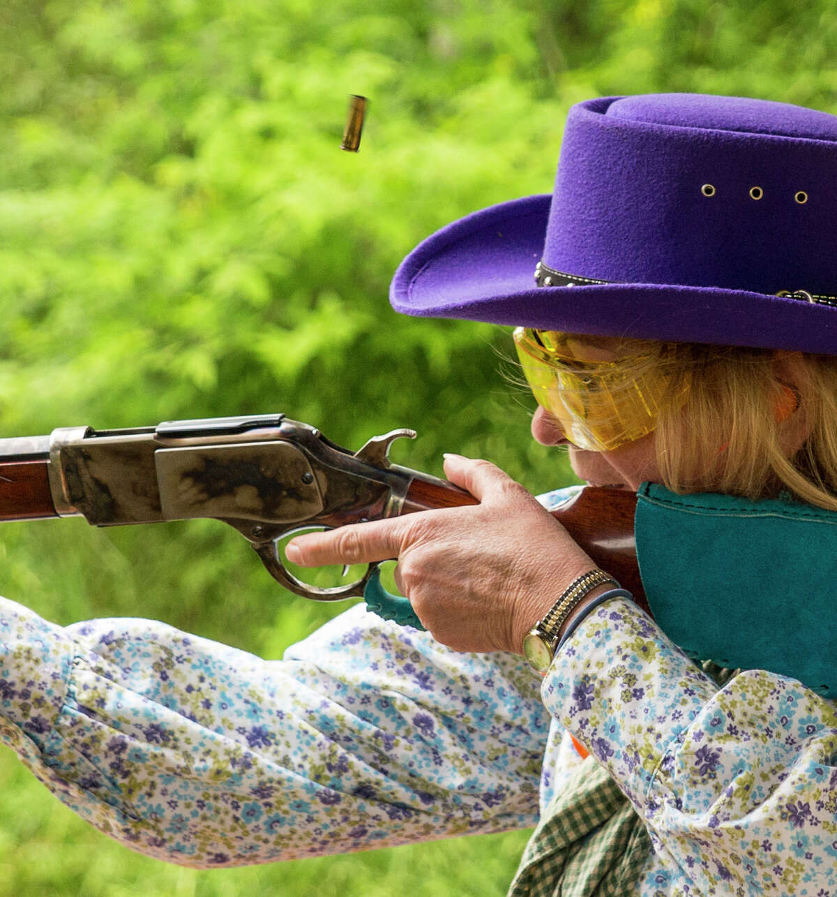A shell flies from the rifle of Debbie Walsh during a cowboy action shooting match at A Place to Shoot in San Antonio on April 4, 2015. Walsh is a member of the South Texas Pistolaros, a cowboy action shooting club.