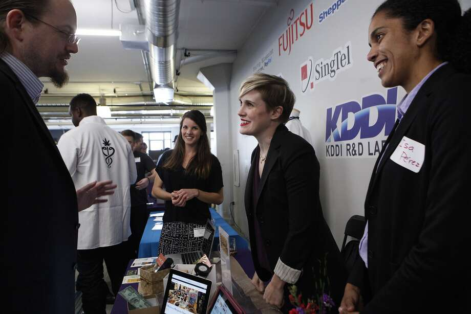"""(R-L) Synchronicity cofounders Isamarie Perez, Amanda Conley and Chelsey McKrill speak to Dave Hodges about their company during the 420 Pitch event, Monday, May 11, 2015, in San Francisco, Calif. The event brought together weed entrepreneurs and tech investors. The company's slogan is """"Cannabis curated for women, by women."""" Photo: Santiago Mejia, The Chronicle"""