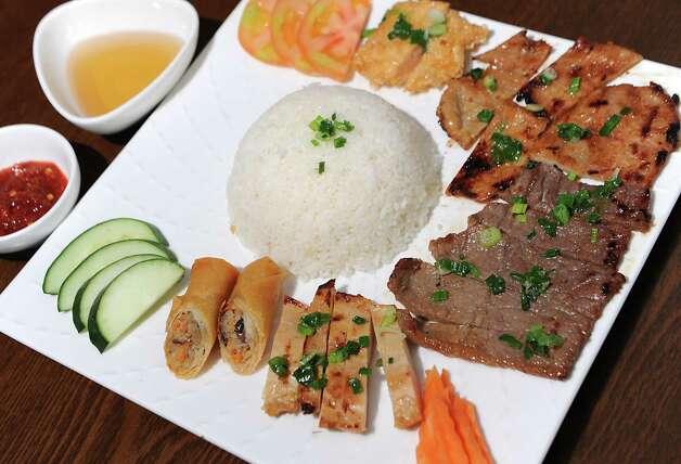Saigon special com tam broken rice dish at Saigon Pearl restaurant on Friday, May 8, 2015 in Albany, N.Y. (Lori Van Buren / Times Union) Photo: Lori Van Buren / 00031766A