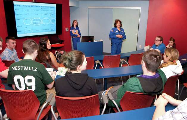 Commander Marie Dicristofaro talks to students from Tech Valley High School at the briefing room at the Museum of Innovation and Science on Thursday, May 14, 2015 in Schenectady, N.Y. The new Challenger Learning Center opened in the museum today. (Lori Van Buren / Times Union) Photo: Lori Van Buren / 00031850A