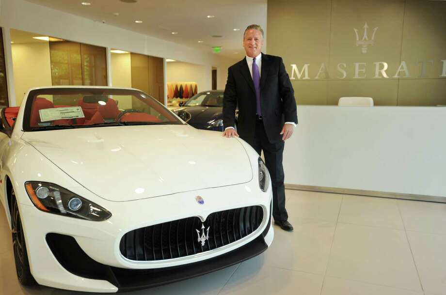 Sales Manager Tim Coughlin stands with a Gran Turismo Cab MC at Maserati of Westport at 1026 Post Road East in Westport, Conn. on Thursday, May 14, 2015. Photo: Brian A. Pounds / Connecticut Post