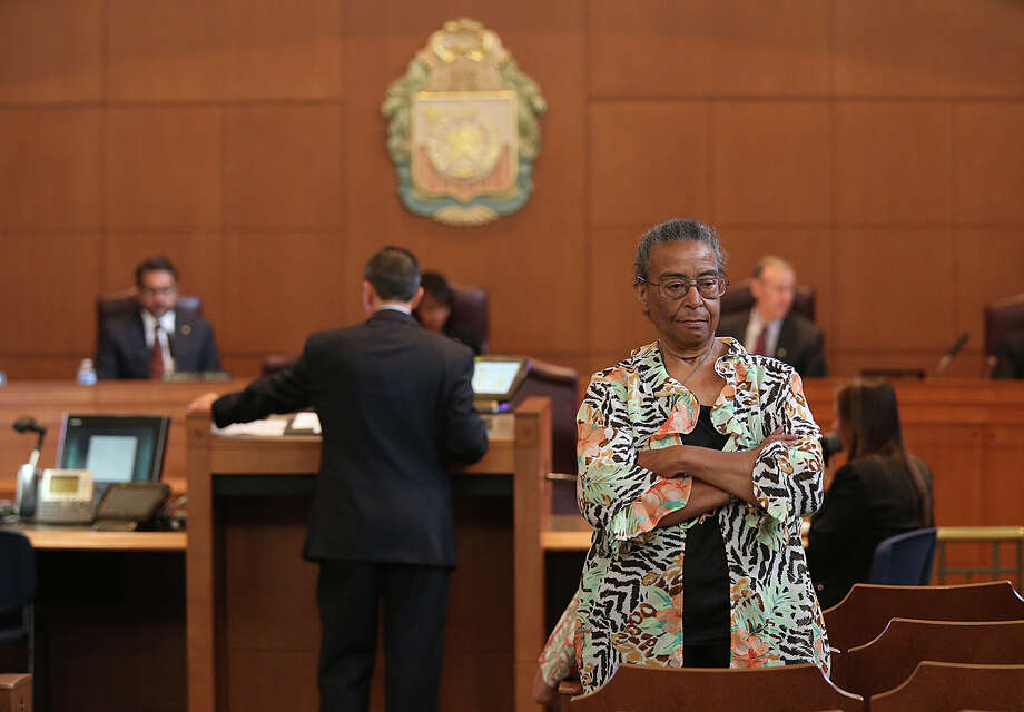 Nettie Hinton turns her back on the San Antonio City Council as assistant city manager Carlos Contreras formally presents a report on how to address gentrification during a regular meeting, Thursday, May 14, 2015. Hinton is a member of the Mayor's Task Force on Preserving Dynamic and Diverse Neighborhoods, which generated the report. The council unanimously accepted the report that drew demands by two committee members and community activists to delay the vote because they said the proposals did not do enough to address the economic threats to the city's most vulnerable residents. Photo: JERRY LARA /San Antonio Express-News / © 2015 San Antonio Express-News