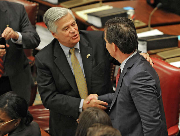 Senator Dean Skelos, left, congratulates Senator John Flanagan after Flanagan received the oath of office to be the new Senate Majority Leader in the Senate Chamber at the Capitol on Monday, May 11, 2015 in Albany, N.Y. (Lori Van Buren / Times Union) Photo: Lori Van Buren, Albany Times Union