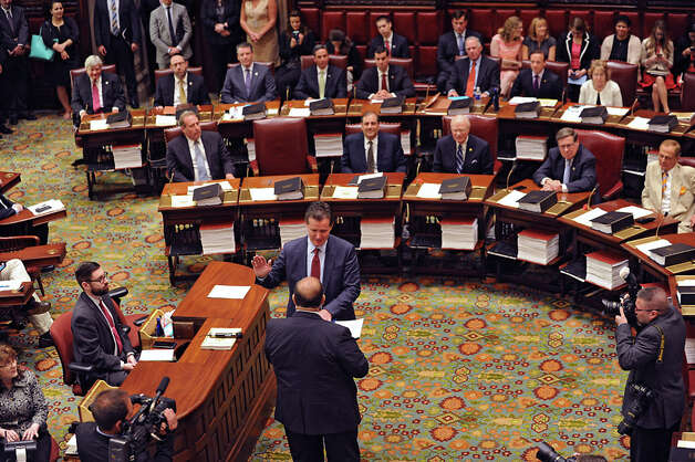 Senate Secretary Frank Patience administers the oath of office to Senator John Flanagan as the new Senate Majority Leader in the Senate Chamber at the Capitol on Monday, May 11, 2015 in Albany, N.Y. (Lori Van Buren / Times Union) Photo: Lori Van Buren, Albany Times Union