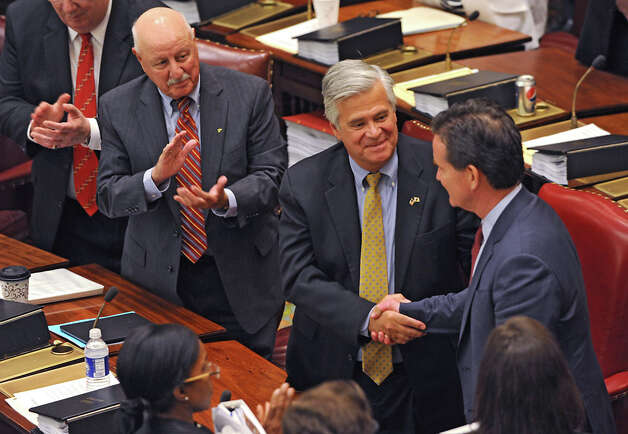 Senator Dean Skelos, center, congratulates Senator John Flanagan, right, after Flanagan received the oath of office to be the new Senate Majority Leader in the Senate Chamber at the Capitol on Monday, May 11, 2015 in Albany, N.Y. Senator Kenneth LaValle, left, applauds. (Lori Van Buren / Times Union) Photo: Lori Van Buren, Albany Times Union