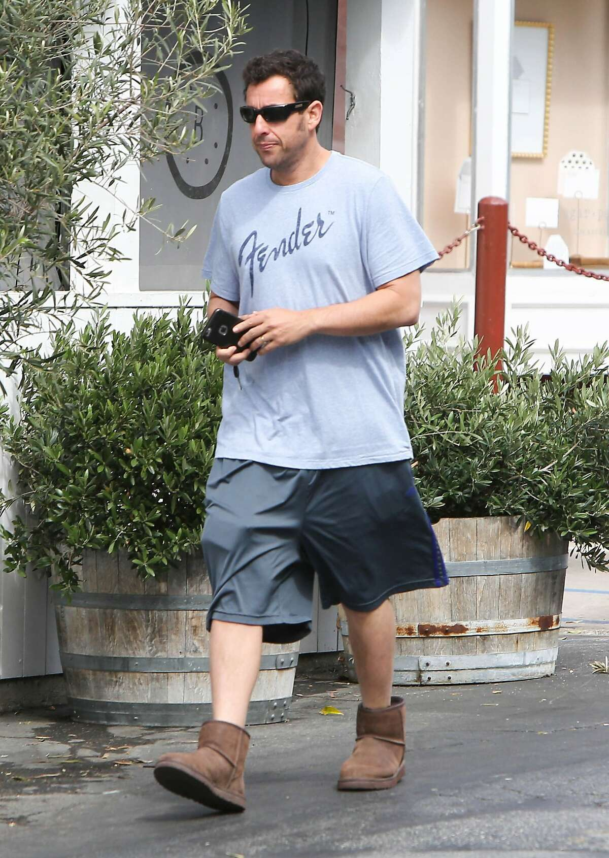 Adam Sandler has often embodied the dad physique, although most dads forgo the Uggs with shorts look.