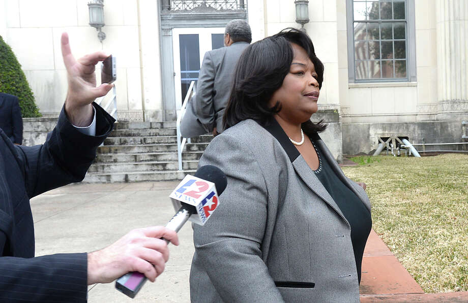 Former Central High School principal Patricia Lambert exits the Federal Courthouse after being indicted on several counts of alleged fraud and embezzlement, as well as engaging in an alleged conspiratorial scheme with the assistance of Victoria Steward to alter students' state test scores. She pled not guilty to all charges. Photo taken Thursday, February 5, 2015 Kim Brent/The Enterprise Photo: Kim Brent / Beaumont Enterprise