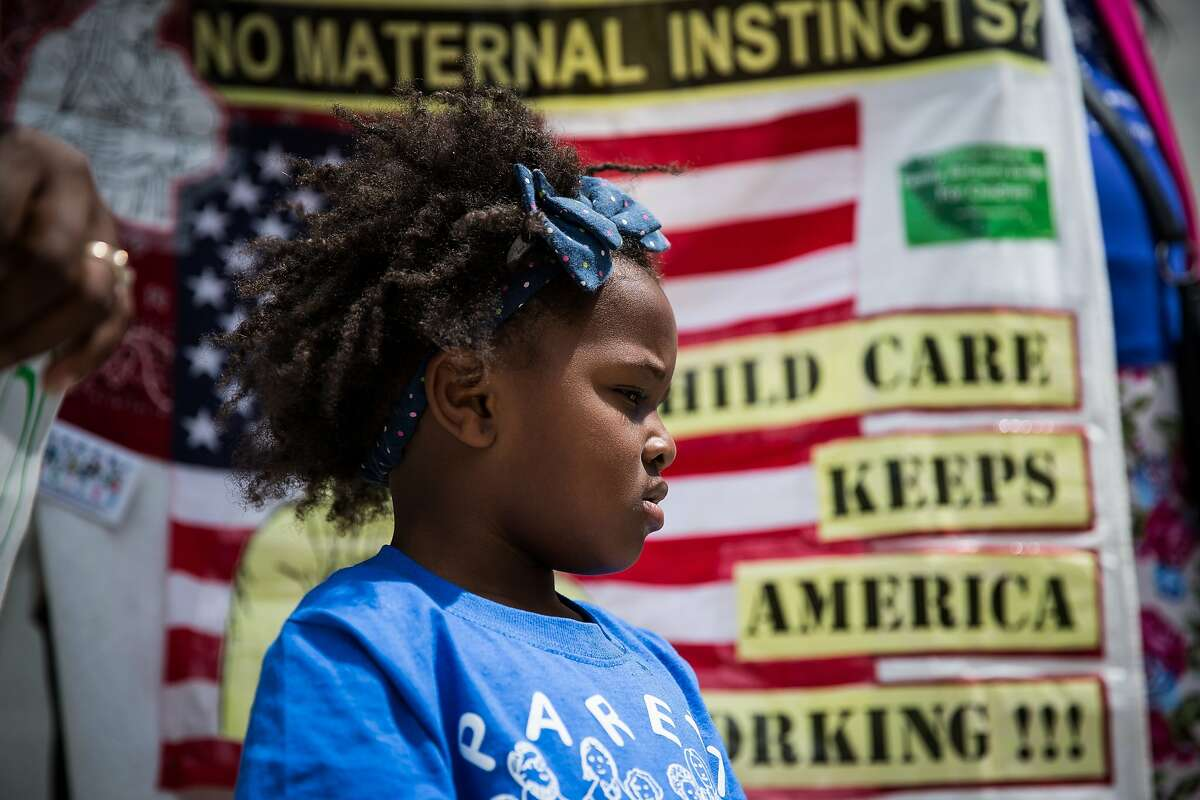 Three-year-old Chloe Jackson attends a protest as her mother calls for more state funding for child care after California Gov. Jerry Brown announced his revised state budget at the State Capitol in Sacramento, California, May 14, 2015. Brown's budget revise includes increased funding for schools, the rainy day fund, and creates a new state earned income credit.