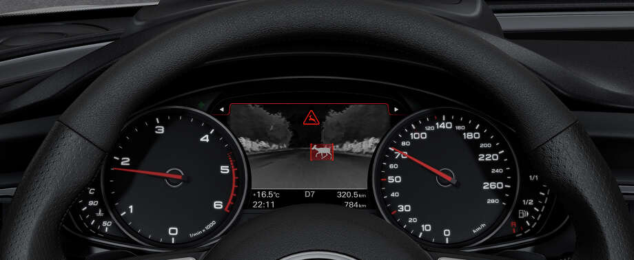 """Autoliv will launch the fourth generation night vision system. Night vision, unlike the visible images you see illuminated in your headlights, """"sees""""  heat reflected from other vehicles, pedestrians, and even some animals. Pictured: Autoliv night vision system of deer in Audi dash display."""