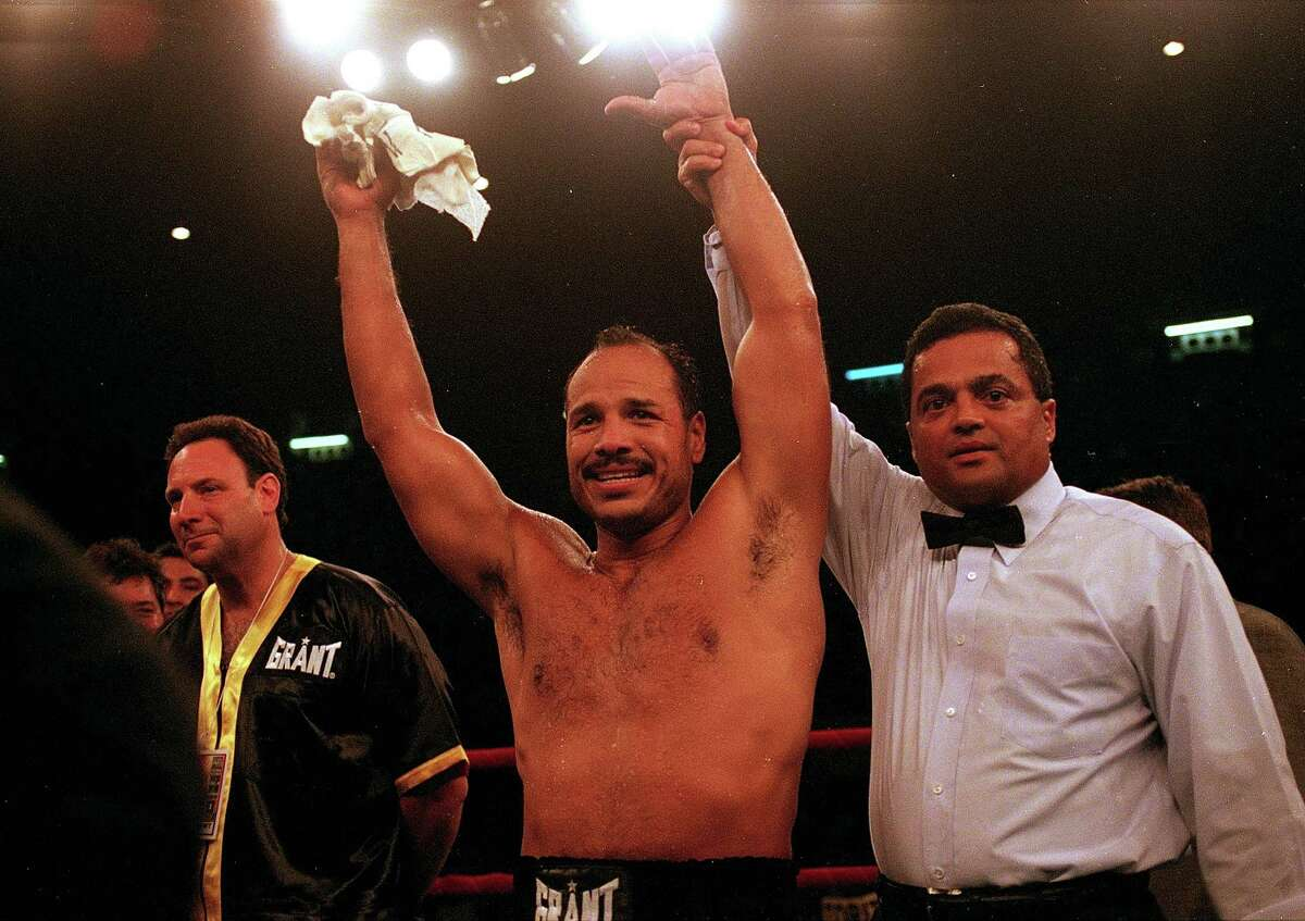 Tony Ayala Jr. celebrates after the fight against Manuel Esparaza at the Freeman Coliseum in San Antonio on Aug. 20, 1999. Ayala won by TKO in the third round.
