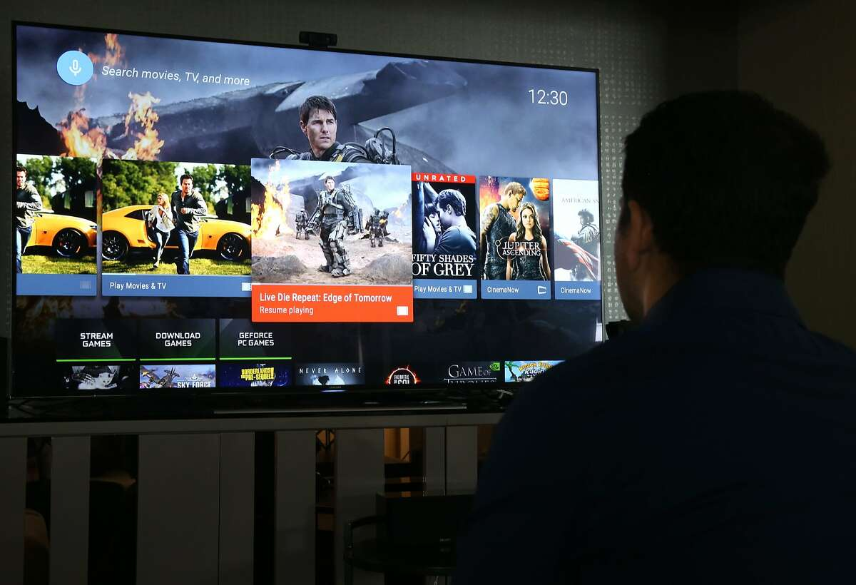 Sridhar Ramaswamy, director of technical marketing for the Nvidia Shield, navigates through the menus on the video streaming device in San Francisco, Calif. on Thursday, May 14, 2015. The Shield runs on the Android TV operating system and is capable of streaming 4K Ultra high definition video content as well as a number of games. NOTE: STORY AND PHOTOS ARE EMBARGOED UNTIL 12:00 PM ON THURSDAY, MAY 28, 2015.