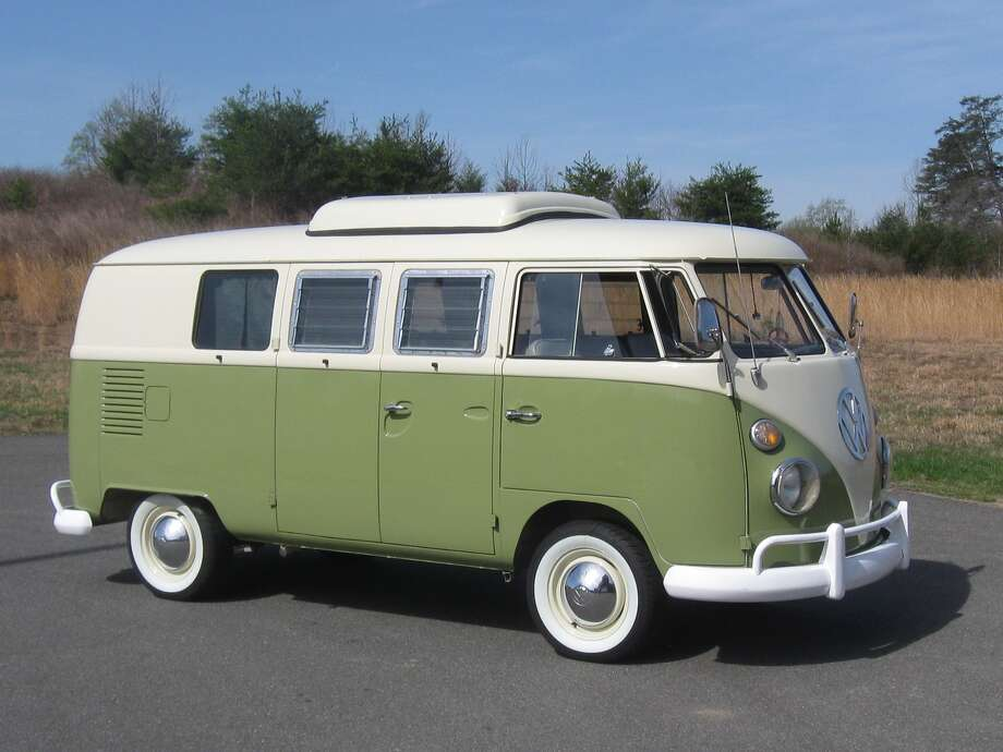 The bulbous chrome hubcaps and the king-sized VW initials on the nose below the two-piece windshield add a touch of sparkle to the otherwise plain bus.