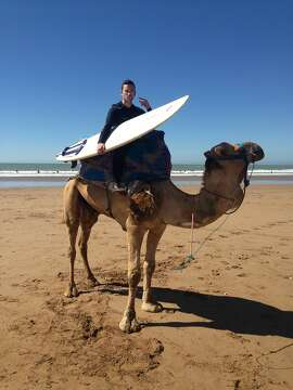 Greg Friedman of Berkeley with his surf caddie, Mustafa, at Taghazout, Morocco.
