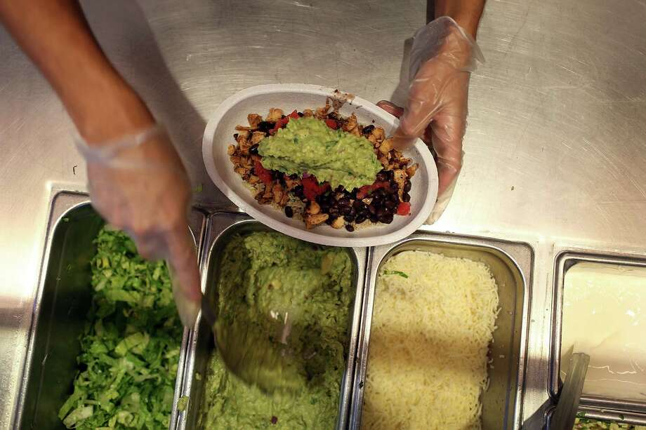 MIAMI, FL - APRIL 27:  Chipotle restaurant workers fill orders for customers on the day that the company announced it will only use non-GMO ingredients in its food on April 27, 2015 in Miami, Florida.  The company announced, that the Denver-based chain would not use the GMO's, which is an organism whose genome has been altered via genetic engineering in the food served at Chipotle Mexican Grills.  (Photo by Joe Raedle/Getty Images) Photo: Joe Raedle / Getty Images / 2015 Getty Images