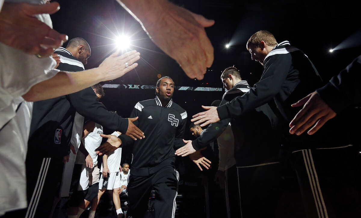Spurs' Kawhi Leonard is introduced before Game 6 of the first round of the Western Conference playoffs against the Los Angeles Clippers on April 30, 2015 at the AT&T Center.
