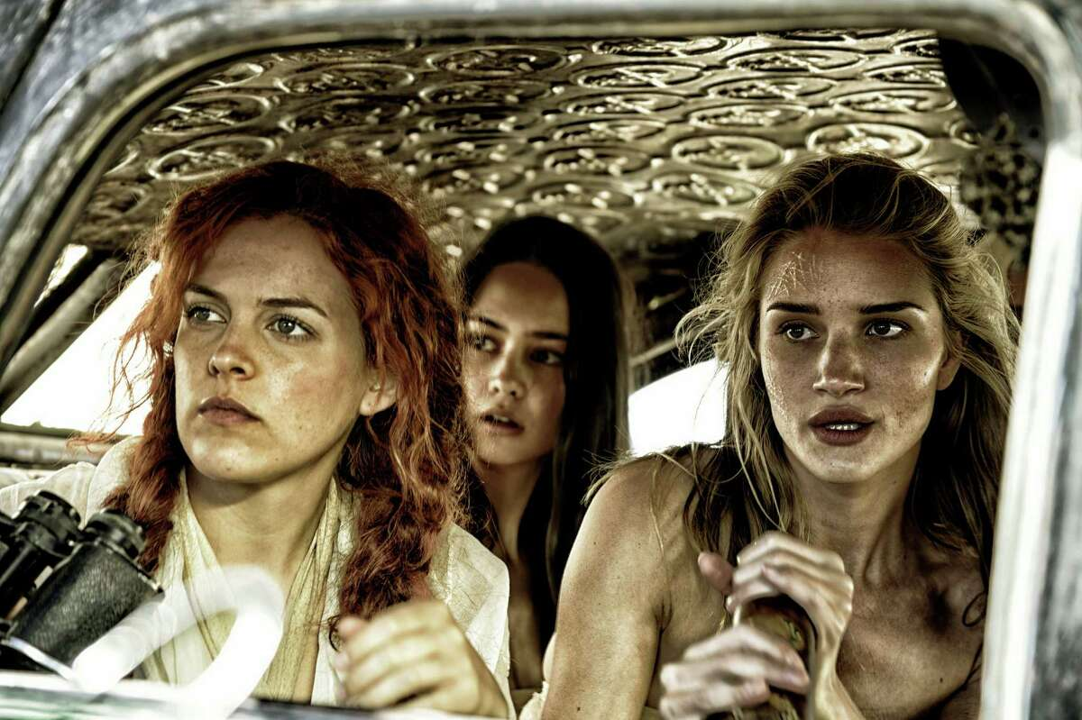 """This photo provided by Warner Bros. Pictures shows, from left, Riley Keough as Capable, Courtney Eaton as Cheedo the Fragile, and Rosie Huntington-Whiteley as The Splendid Angharad, in Warner Bros. Pictures?' and Village Roadshow Pictures?' action adventure film, ?""""Mad Max:Fury Road,"""" a Warner Bros. Pictures release. (Jasin Boland/Warner Bros. Pictures via AP) ORG XMIT: CAET484"""