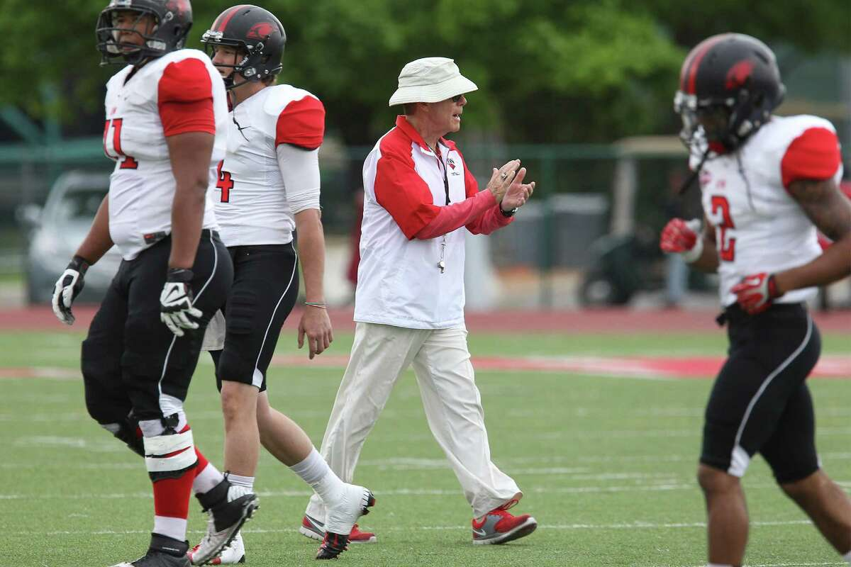 UIW head football coach Larry Kennan encourages his team during the Cardinals' spring game at Benson Stadium on April 5, 2014.